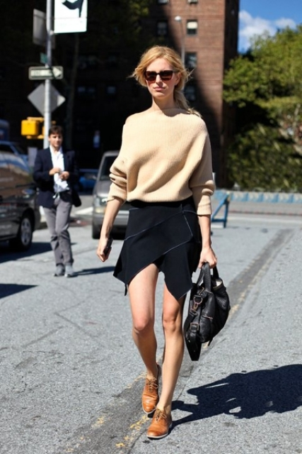With oversized sweater and unique black skirt