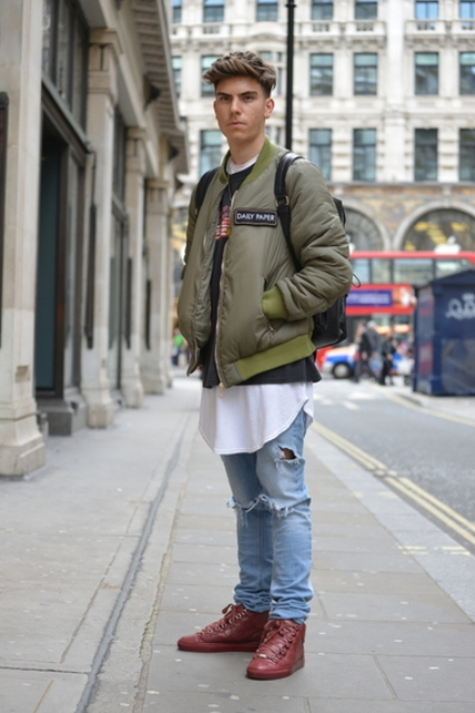 With oversized white t-shirt, printed sweater, jeans and marsala boots