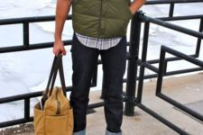 With plaid shirt, puffer vest, cuffed jeans and big bag