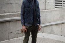 With polka dot shirt, olive green pants, boots and beanie