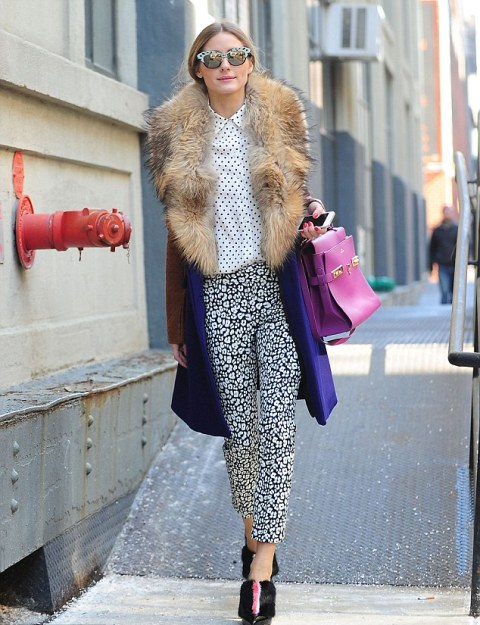 With polka dot shirt, printed trousers and purple bag