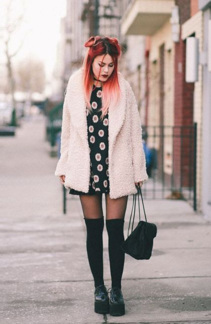 With printed mini dress, platform boots and mini backpack