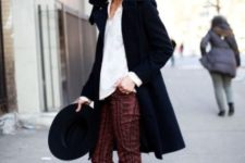 With printed pants, white shirt, black coat and hat