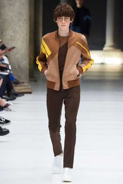 With printed shirt, brown trousers and white sneakers