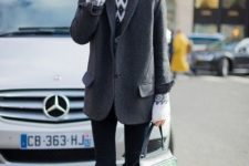 With printed sweater, cuffed pants and gray short coat