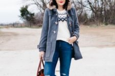 With printed sweater, distressed jeans and red tote