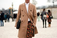 With printed trousers, white button down shirt and black shoes