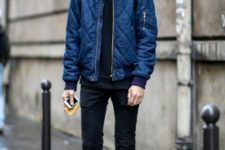 With puffer jacket, cap and black jeans