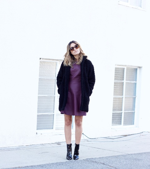 With purple dress and mid calf boots