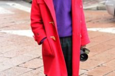 With purple sweater, plaid pants and hat