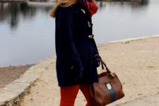 With red pants, duffle coat, plaid scarf, beanie and two color bag