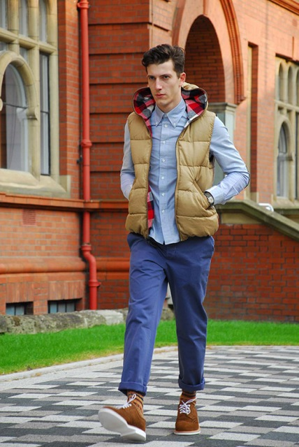 With shirt, cuffed blue pants and suede boots