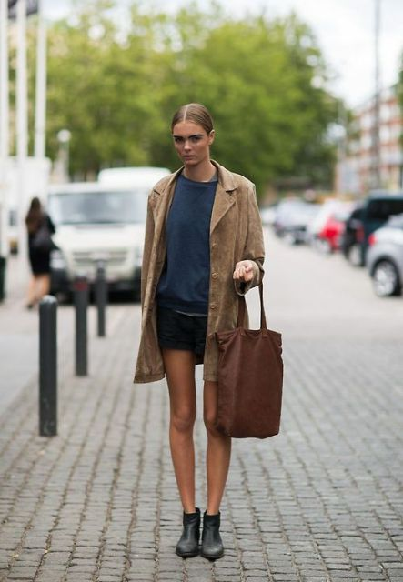 With shirt, mini skirt and brown tote