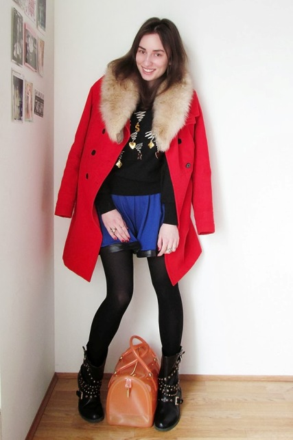 With shirt, mini skirt, black tights, mid calf boots and leather bag
