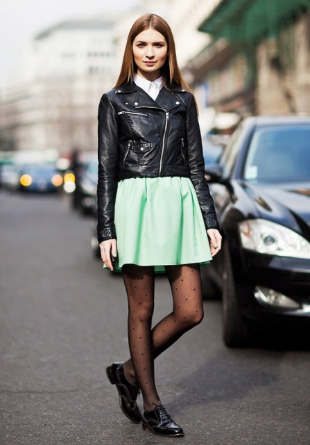With skater skirt, leather jacket and printed tights