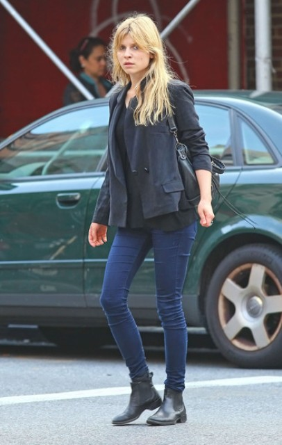 With skinny jeans, jacket and black bag