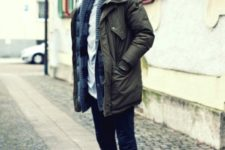 With skinny jeans, shirt and navy blue cardigan