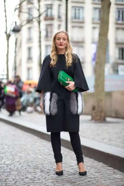 With skinny pants, shoes and green clutch