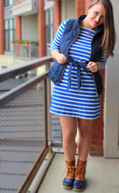 With striped dress and puffer vest