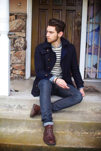 With striped shirt, cuffed jeans and brown shoes