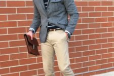 With striped sweater, camel pants, leather belt, tweed jacket and cap