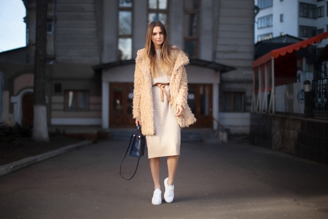 With sweater dress, belt and white sneakers