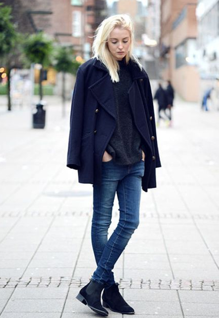 With sweater, navy blue jacket and skinny jeans
