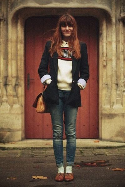 With sweater, skinny jeans, white socks and black blazer