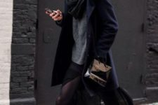 With sweater, skirt, navy blue coat and black scarf