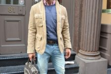 With sweatshirt, distressed jeans and camel jacket
