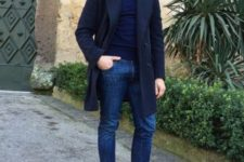 With turtleneck, classic jeans and black shoes