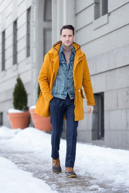 Men outfit with boots, turtleneck, denim jacket, yellow coat and navy blue trousers