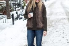 With turtleneck, fur vest, jeans and white beanie