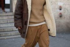 With turtleneck, relaxed-legged pants and mid calf boots