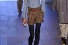 With turtleneck sweater, checked shorts and black tights