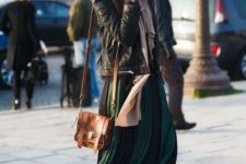 With two color pleated skirt, leather jacket, oversized scarf ad brown mini bag