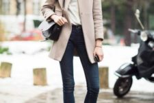 With white blouse, jeans and pastel coat