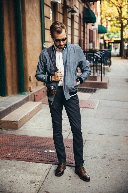 With white button down shirt, deep gray trousers and brown shoes