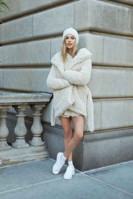 With white mini dress, beanie and sneakers