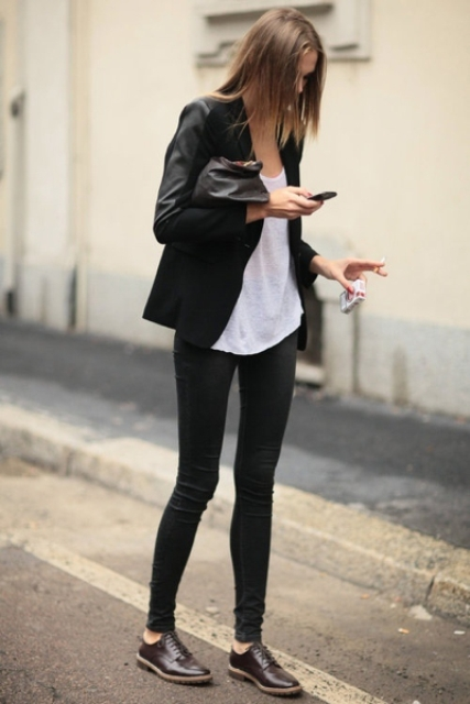 With white shirt, black jacket and skinnies