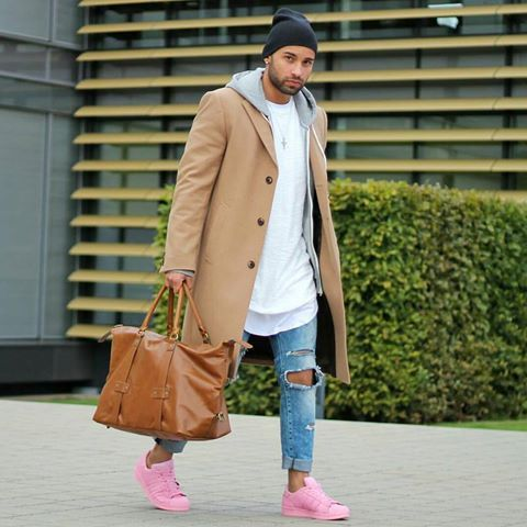 With white shirt, distressed jeans, pink sneakers and leather big bag