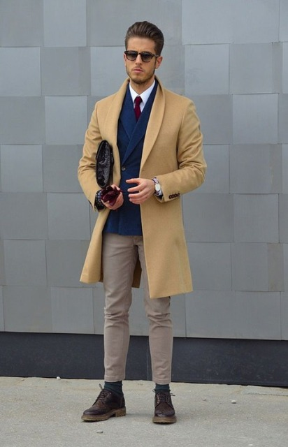 With white shirt, marsala tie, navy blue blazer, beige pants and boots
