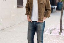 With white shirt, suede jacket and jeans