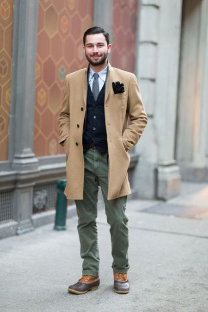 With white shirt, tie, vest, olive green pants and camel coat