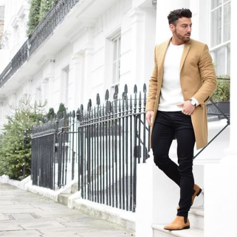 With white sweater, black pants and camel coat