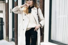 With white sweater, coat and distressed black jeans