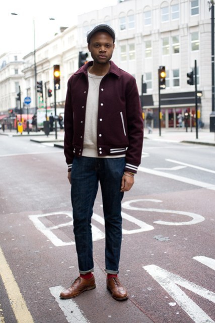 With white sweater, cuffed jeans and brown shoes