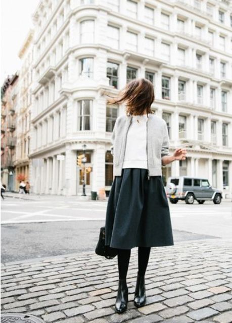 With white sweater, emerald skirt and light gray jacket