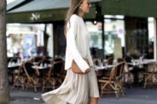 With white sweater, pleated skirt and crossbody bag