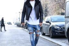 With white t-shirt, distressed jeans and gray boots